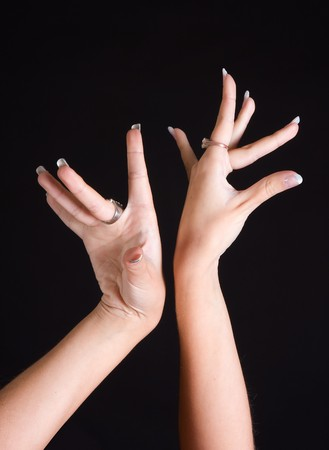 Detail of the graceful hands of a young Spanish flamenco dancer Stock Photo
