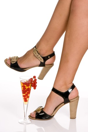 Closeup of a woman's legs and a red berry cocktail Stock Photo - 3998319
