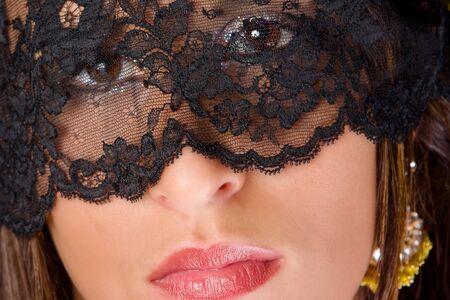 Sensual eyes hidden behind a black lace veil Stock Photo - 3995012