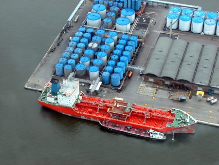 unload: Helicopter view of Antwerp harbor, with a huge tanker ship