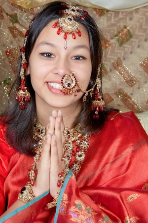 namaste: Young Indian beauty giving the Namaste greeting from India Stock Photo