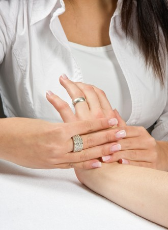 acupressure hands: Professional masseuse giving a woman a hand massage Stock Photo