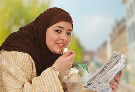 Young islamic woman enjoying ice cream in the sunshine
