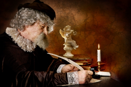 Rembrand style photo of a historical figure writing with a goose feather Stock Photo