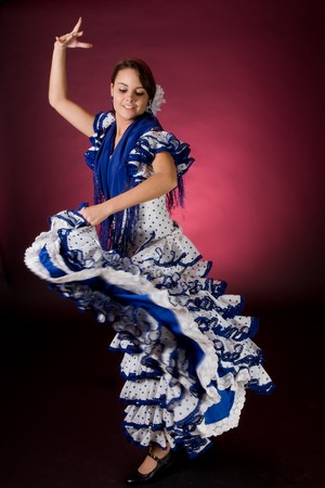 flamenco: Young Spanish flamenco dancer in a blue dress, in full motion