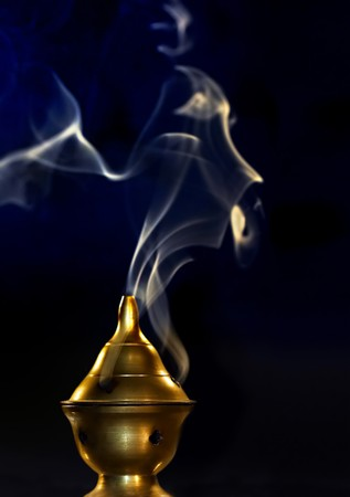 Copper bowl with incense burning, and smoke waves Stock Photo - 4037807