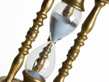 mesure: Bronze hourglass against a white background