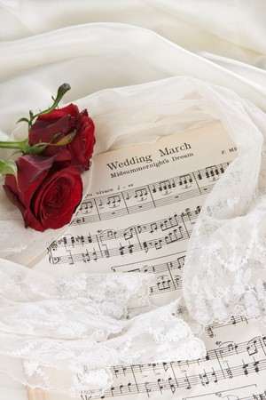 Sheet music of the Wedding March with roses and bridal veil Stock Photo