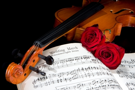 Sheet music of the Wedding March, with roses and violin photo