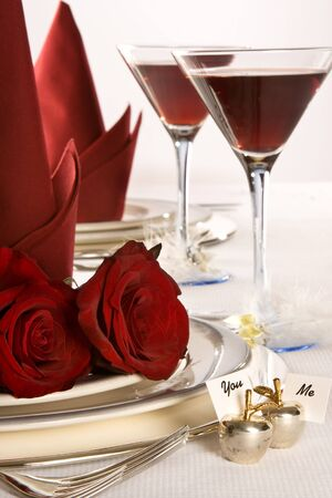 china rose: Roses, wine and name cards on a wedding table