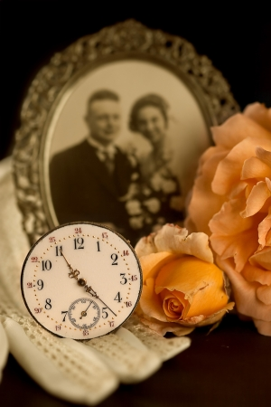 Old wedding photograph, wedding gloves, rose and antique watch Stock Photo