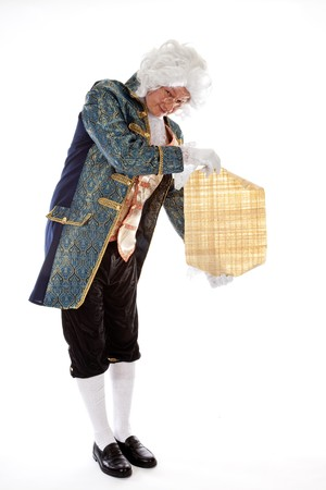 livery: Lackey in victorian livery costume presenting a message on parchment Stock Photo