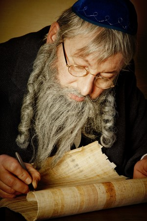 judaism: Old jewish man with beard writing on a parchment scroll Stock Photo
