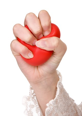 Hands of a woman squeezing a stress ball Stock Photo - 4160929