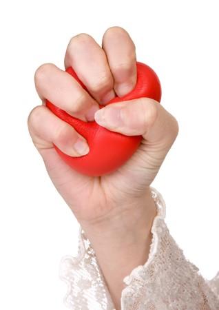 squeezed: Manos de una mujer apretando una pelota antiestr�s Foto de archivo