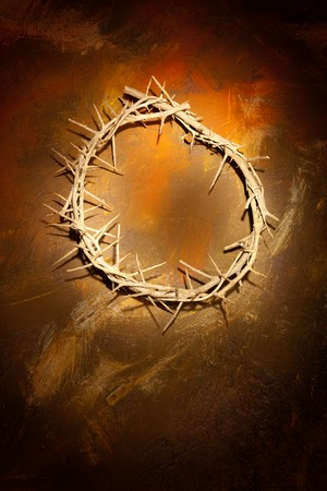 Holy crown of thorns hanging on a grungy wall at Easter Stock Photo