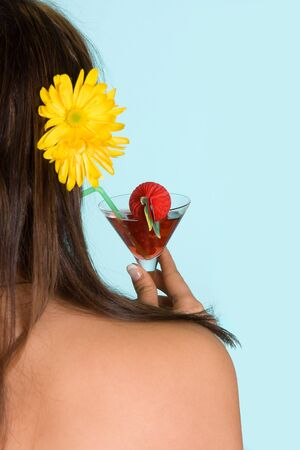 Young woman drinking a red summer cocktail Stock Photo - 4197224