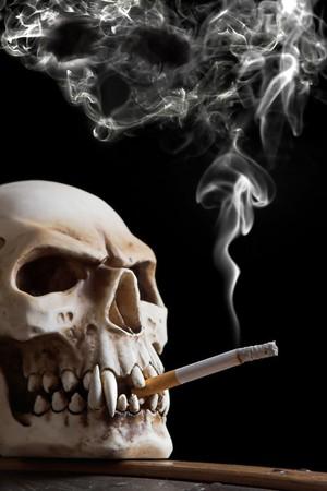 Smoking skull, the smoke has the form of a skull too photo