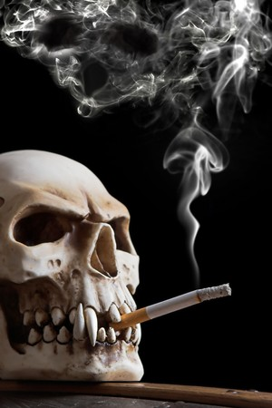 cigarette filter: Smoking skull, the smoke has the form of a skull too Stock Photo