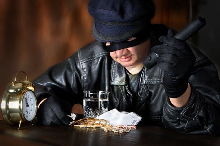 stealer: Burglar finding a big loot of diamonds and jewellery