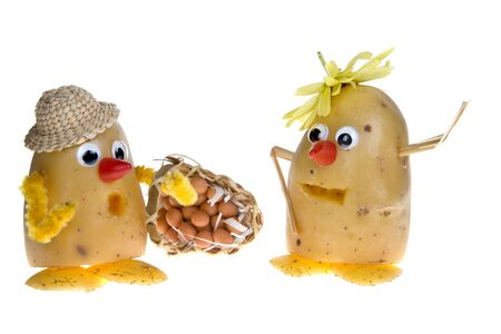 pulling faces: Funny scene of two potatoes wearing hats and googly eyes