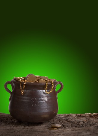 bucket of money: The pot of gold of Saint Patricks day against a shiny green background Stock Photo