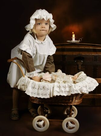 Victorian style photo of a little girl playing with her doll photo