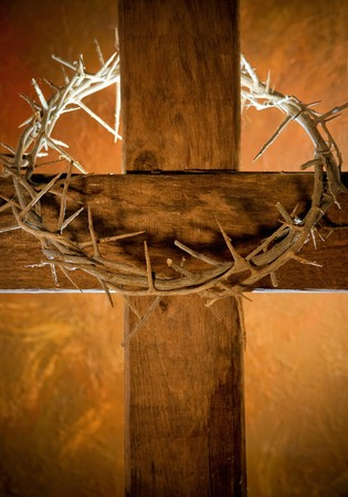 Crown of thorns hanging on a wooden cross at Easter Stock Photo