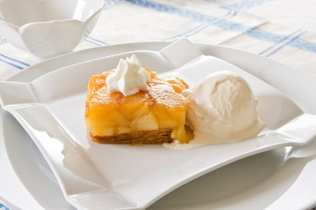 Tarte Tatin, delicious French dessert with puff pastry, apple and ice-cream photo