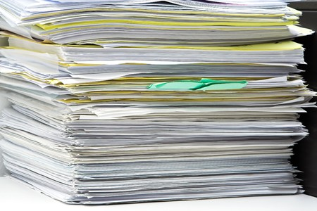 test deadline: Stack of files and paperwork