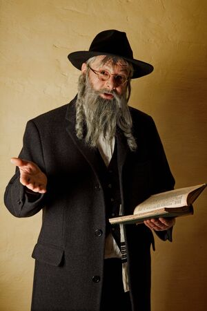 hasidic: Old jewish man with grey beard holding a book