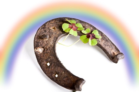 Symbols of good fortune : clover, horse-shoe and rainbow photo