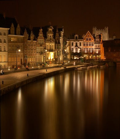 gabled: Beautiful step-gabled guild-houses in medieval Ghent, reflected in its canals
