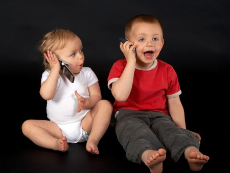18 month old: Little 18 month old girl talking to her brother on the phone