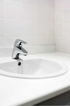 Fresh and clean washbasin and chrome tap Stock Photo