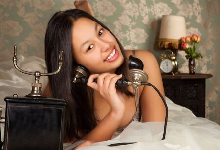 Sensual young woman in lingerie one a phone call Stock Photo - 4358893