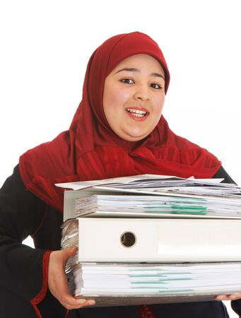 purdah: Young islamic woman carrying papers and office work
