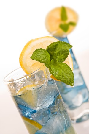 Blue long drink cocktails decorated with lemon and mint Stock Photo - 4408575