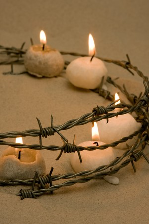 Candles in barbed wire, symbol of civil rights and hope Stock Photo - 4408578