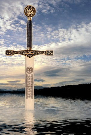 Medieval sword rising from the waters of a Scottish lake