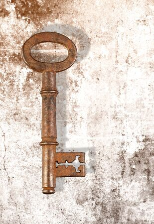 Vintage grunge photo of a rusty key Stock Photo