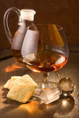 happyhour: Warm light shining through a glass of cognac