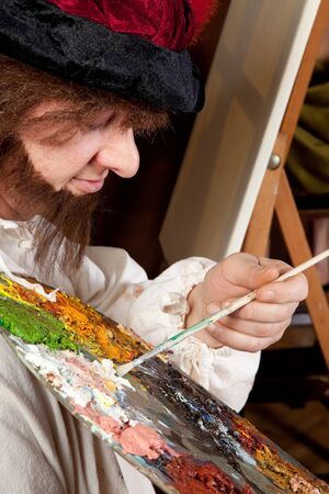 Vintage artist making a painting with pallet and brushes Stock Photo - 4439442