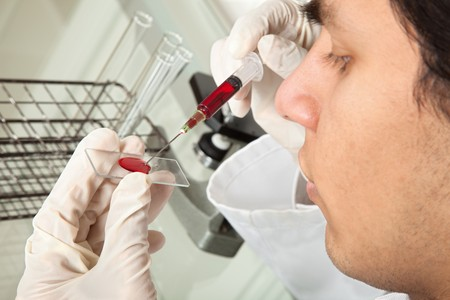 Young law working doing tests with blood Stock Photo - 4439431