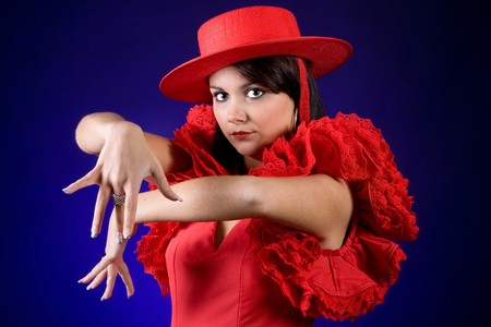 exotic dancer: Young Spanish flamenco dancer performing with a red hat Stock Photo