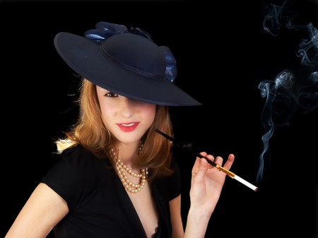chanel: Young smiling woman in black, smoking a cigarette in style