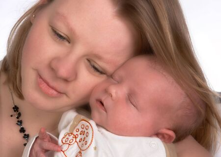 Loving mother enjoying the company of her newborn baby (15 days old) photo