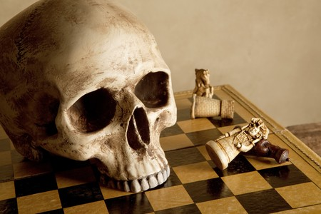 Old human skull on an antique checkboard photo