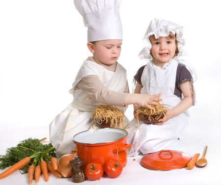 Boy and girl making a mess with spaghetti photo