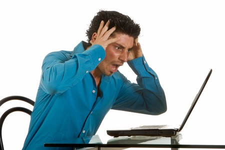 Attractive young man upset after a computer crash Stock Photo - 4489466